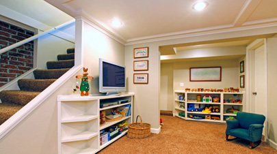Play room in a white basement living room